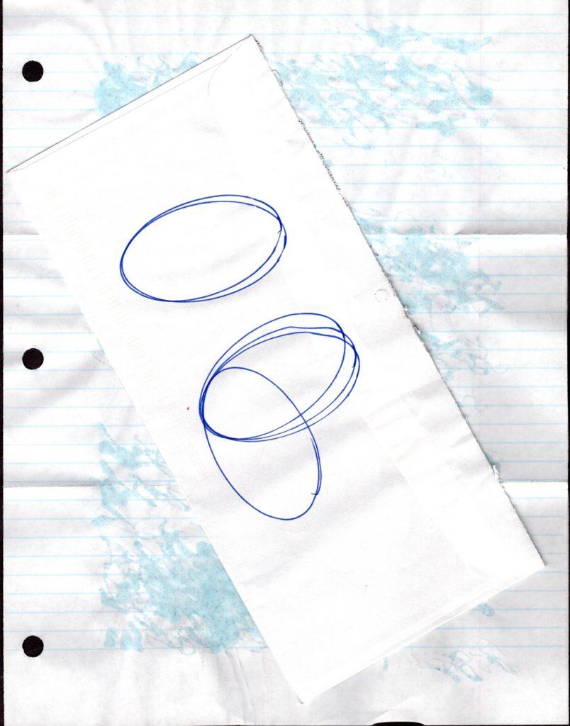 circles drawn on a long white envelope